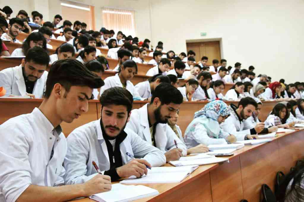 students in college classroom
